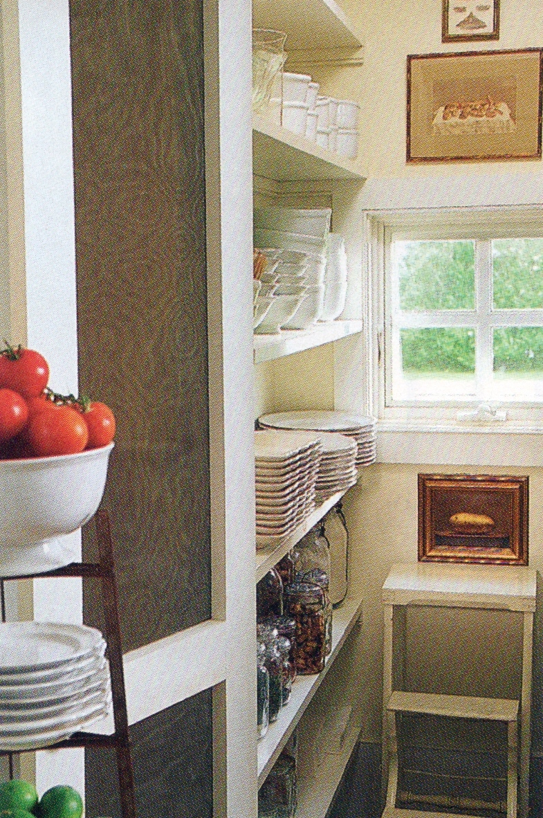 a nice walk-in pantry keeps serving dishes at the ready