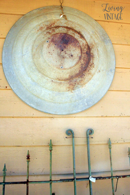 a round metal object that could be transformed into a neat light fixture