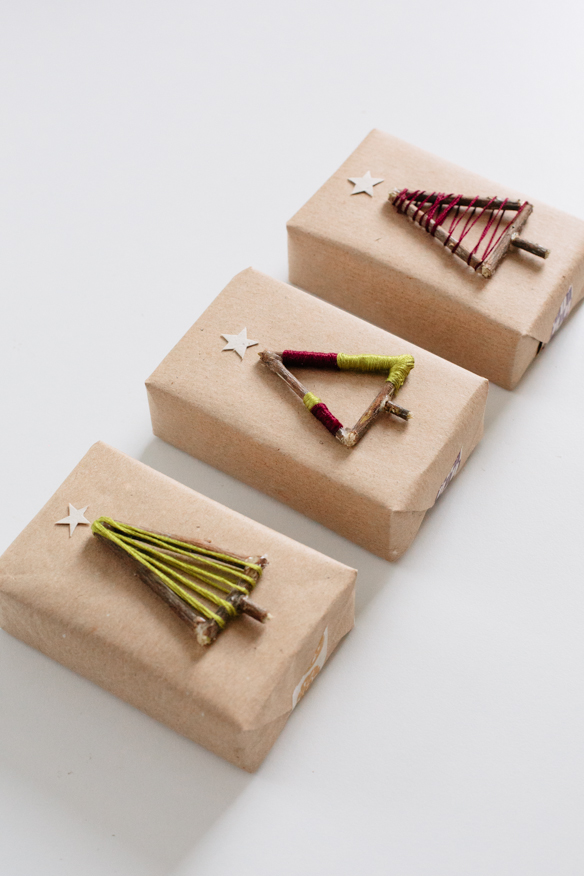 an adorable way to decorate Christmas presents using small branches and leftover yarn - one of 8 picks for this week's Friday Favorites