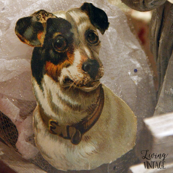 a jack russell illustration, part of an elaborate display of antique Christmas collectibles
