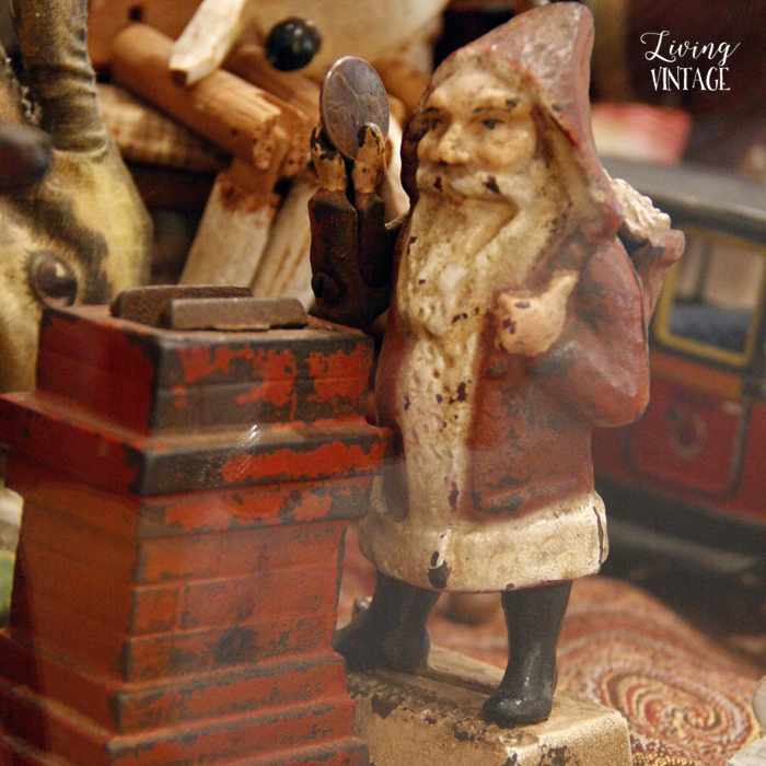 Santa makes a deposit in a cast iron toy bank